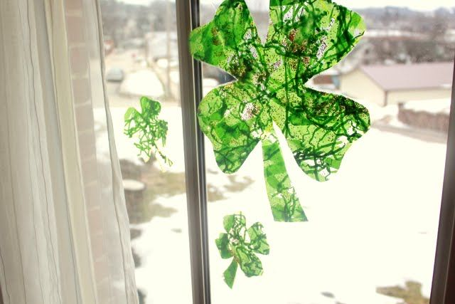 decorating contact paper with some greens (tissue paper, etc) and cut out as a shamrock! I love contact paper crafts for toddlers, what other 'shapes' can we make?