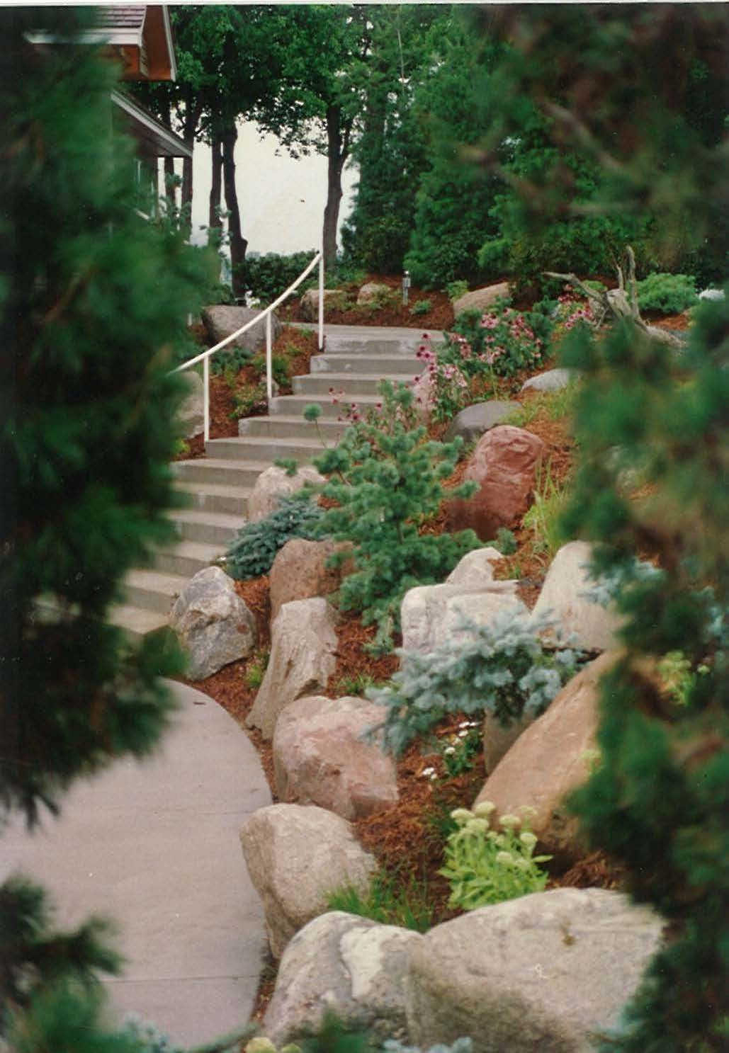 Beautiful Solution To A Steep Hill Beside The Entrance Driveway Garden Solutions Hillside Landscaping Front Yard Landscaping