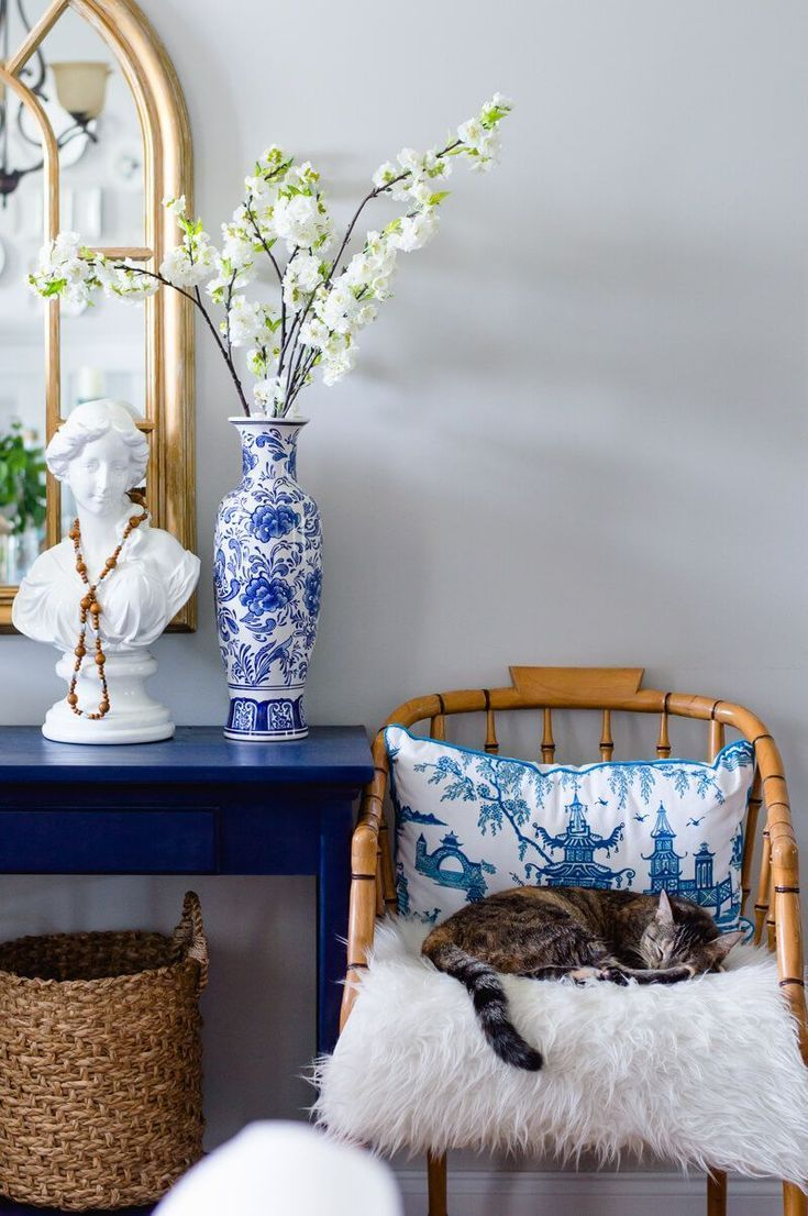 Thehomeicreate.com gorgeous blue and white chinoiserie chic accents, rattan bamboo chair, woven basket, blue console, gold mirror