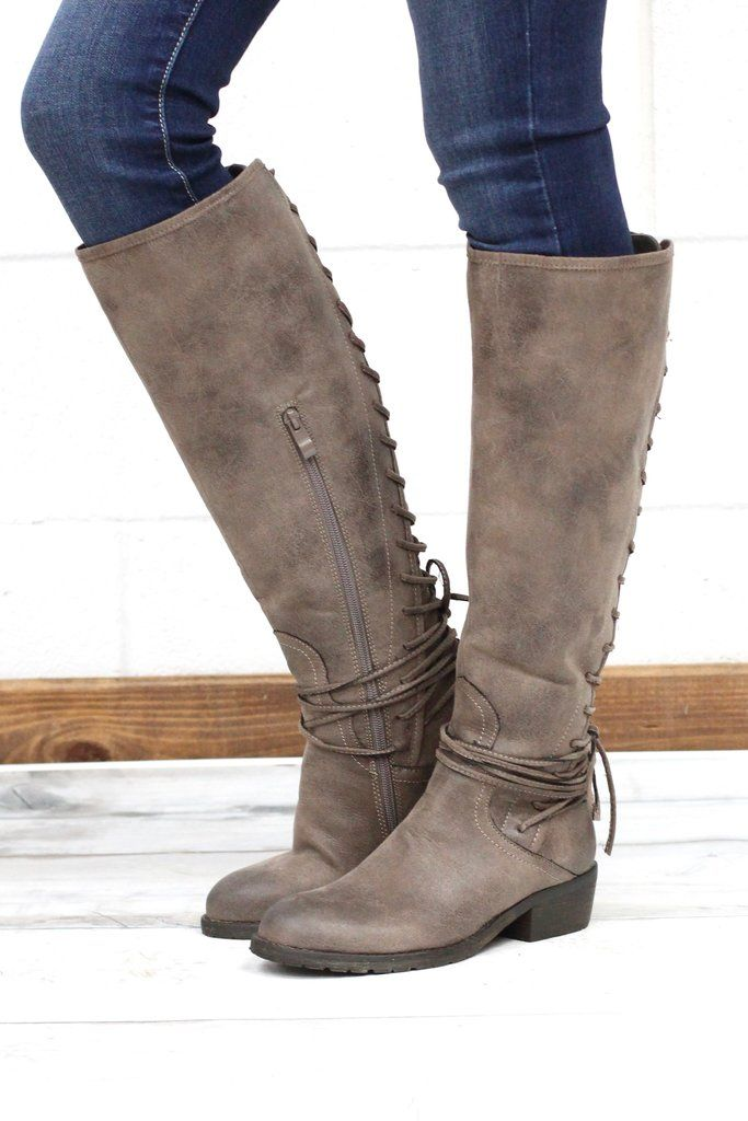 e10a6afa504 These tall riding boots feature a gorgeous lace up back that also wraps  around the ankle. They have a solid back panel and the lace up can be  adjusted to ...