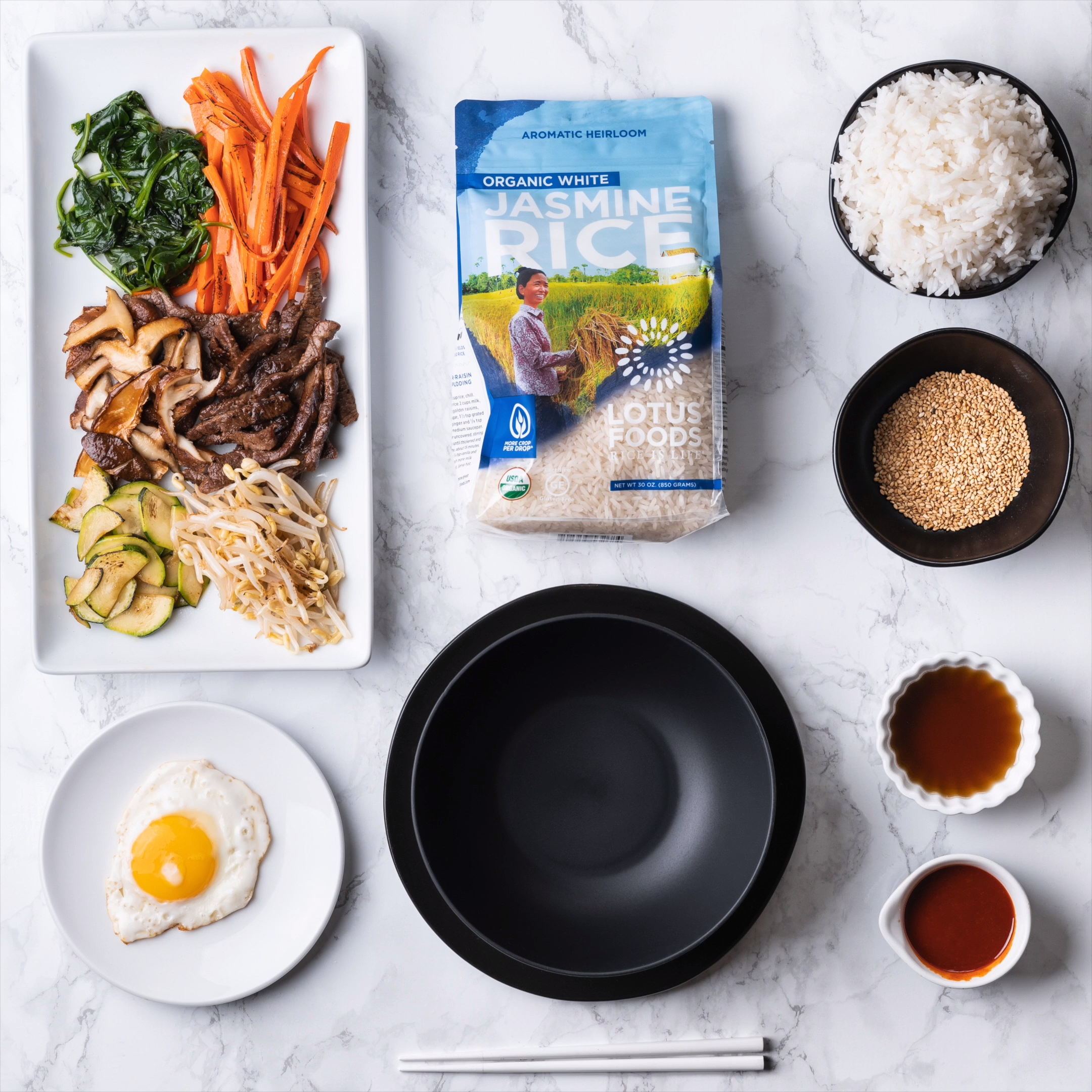 Make your own bibimbap bowl with our Organic Jasmine Rice! This premium variety of Jasmine rice is called Phka Malis, which in Khmer language means beautiful garland of flowers because of its delicate floral aroma. It has a soft, slightly sticky texture and fast cooking time. 📹 @flatlaytoday #lotusfoods #jasminerice #organicrice #bibimbap #bibimbapbowl #morecropperdrop