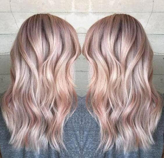 subtly rosy hair highlights in choppy layers