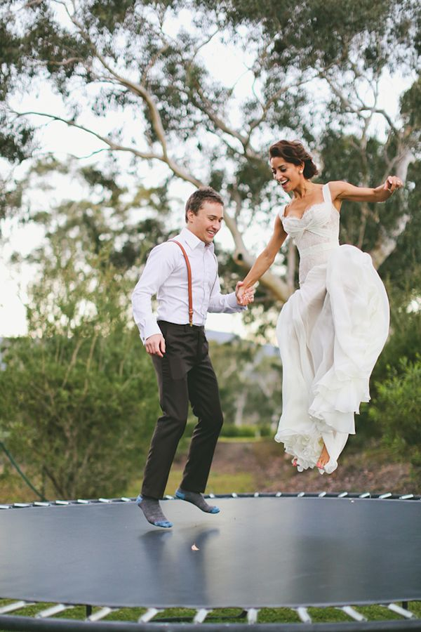 cool wedding shot ideas%0A Trampoline bride and groom love cute wedding outdoors fun trees couple  smile country laugh jump