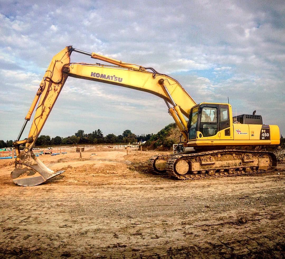 Big Komatsu PC450 resting on a new subdivision. komatsu