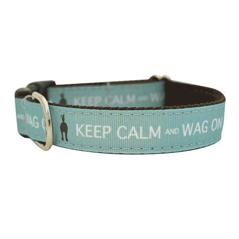 Dogs have such a great outlook on life, don't they? Eat, sleep and play - that's all that matters! Our Keep Calm and Wag On collar captures this amazing spirit perfectly. The collar features a grosgrain ribbon front, with coordinating nylon webbing backing - which means it's not only stylish, but sturdy too!  Made in USA.