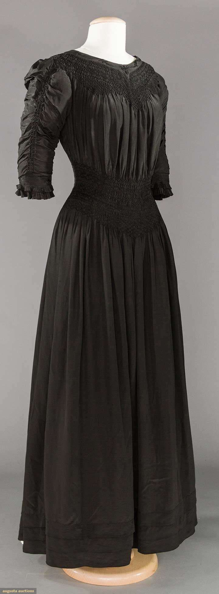 BLACK SILK LIBERTY & CO. AESTHETIC DRESS, 1890-1905  Unlabeled, black China silk, smocked yoke & deep midriff band, embroidered bands at neckline & on sleeve edge, 3 tucks to skirt hem, 14 pair self covered buttons to back
