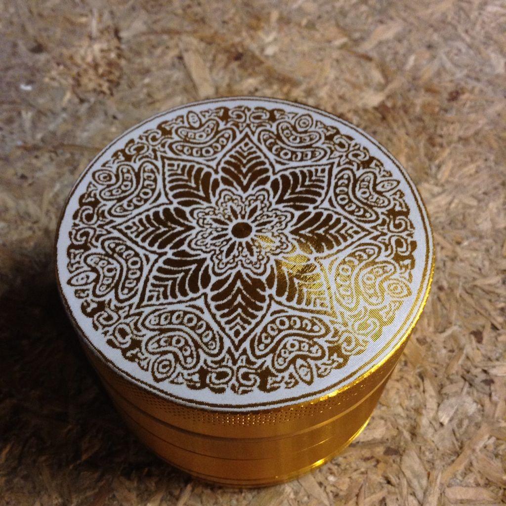 Gold 55mm custom herb grinder! Laser engraved with a Mandala design. To get your own visit www.customherbgrinders.com
