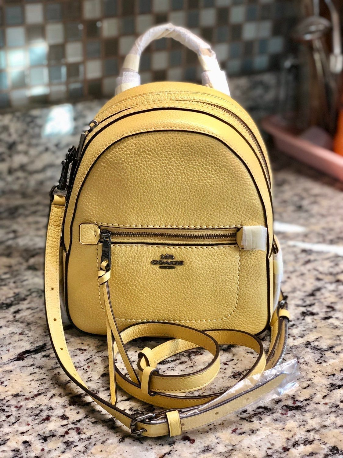 Price is FIRM & Fast shipping! Coach Peble leather andi
