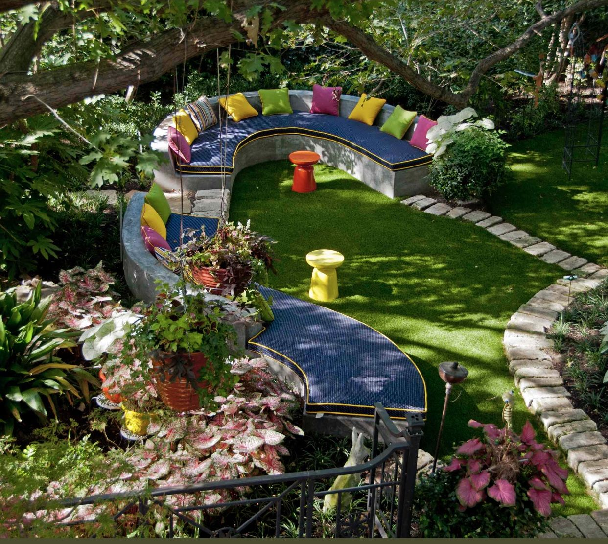 What A Great Outdoor Space So Colorful And Vibrate It Will Uplift Anyone S Day Awesome Job Done Backyard Landscaping Designs Garden Seating Colorful Garden