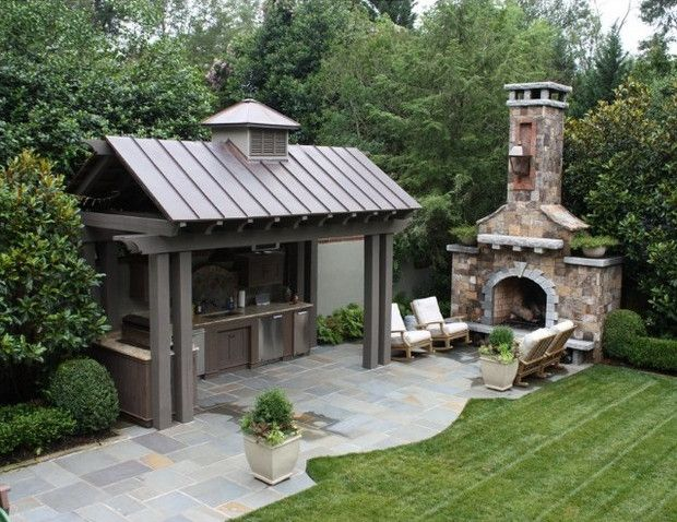 Covered outside kitchen near the outdoor stone fireplace and