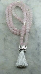 The Lotus mala is made from 108 rose quartz mala beads and pearl. A silver lotus guru bead. Buddhist prayer beads for meditations on love and purity. $80