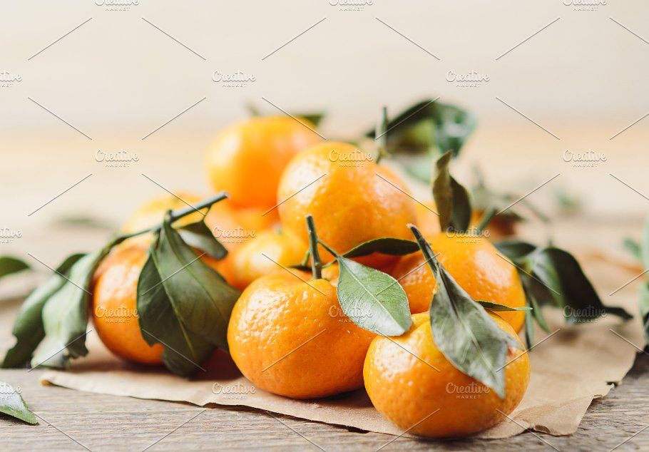 Fresh juicy little tangerines with g with images