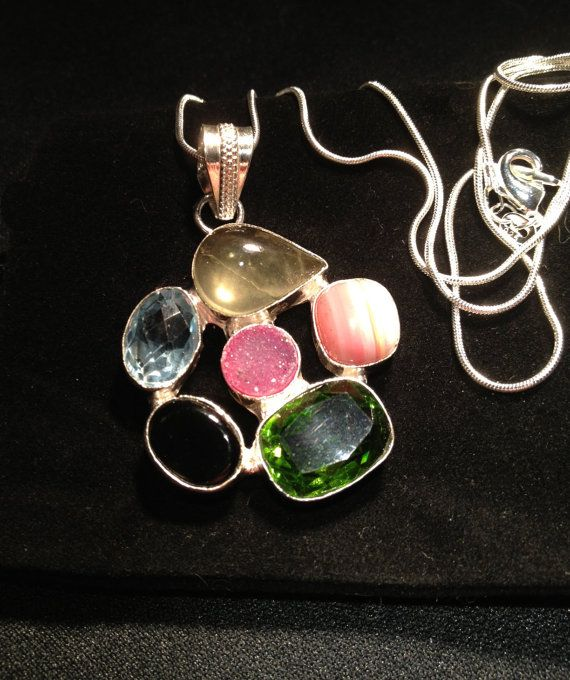 This pendant of sterling bound stones is both a by ObjetDArtifact, $20.00