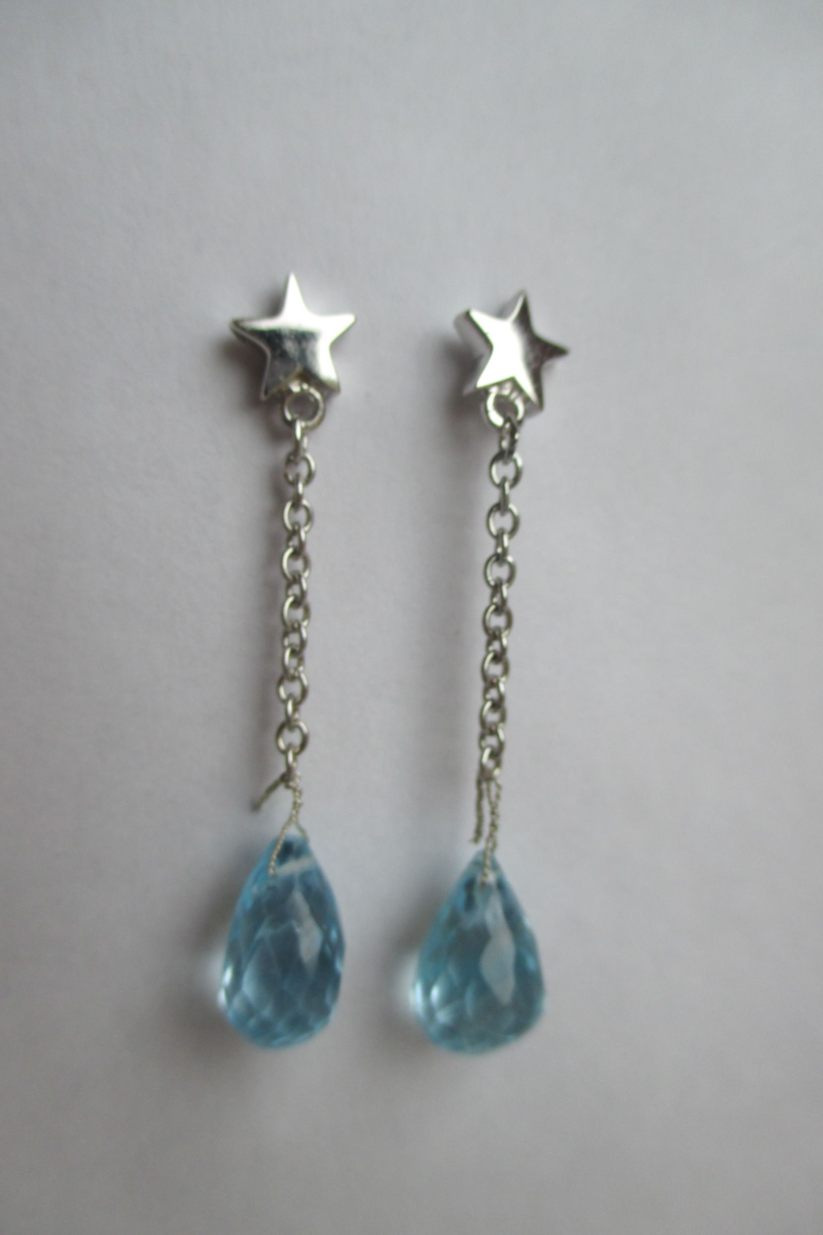 Silver star stud earrings with large Aquamarine drops