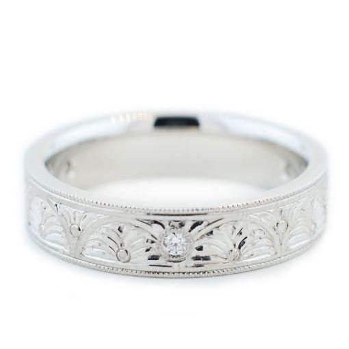 White gold, hand engraved men's wedding ring. Custom Men's Wedding Band by Abby Sparks Jewelry, custom jewelry designer in Denver, Colorado.