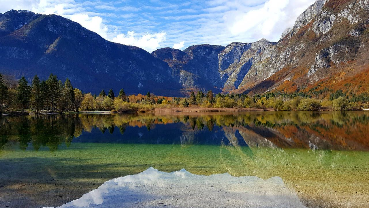 Beautiful Landscape Of A Peaceful Lake Autumn Forest And Mountain Range Reflection Mountain Water Lake Beauty In Nature Scenics Scenic Views Scenic Lake Water