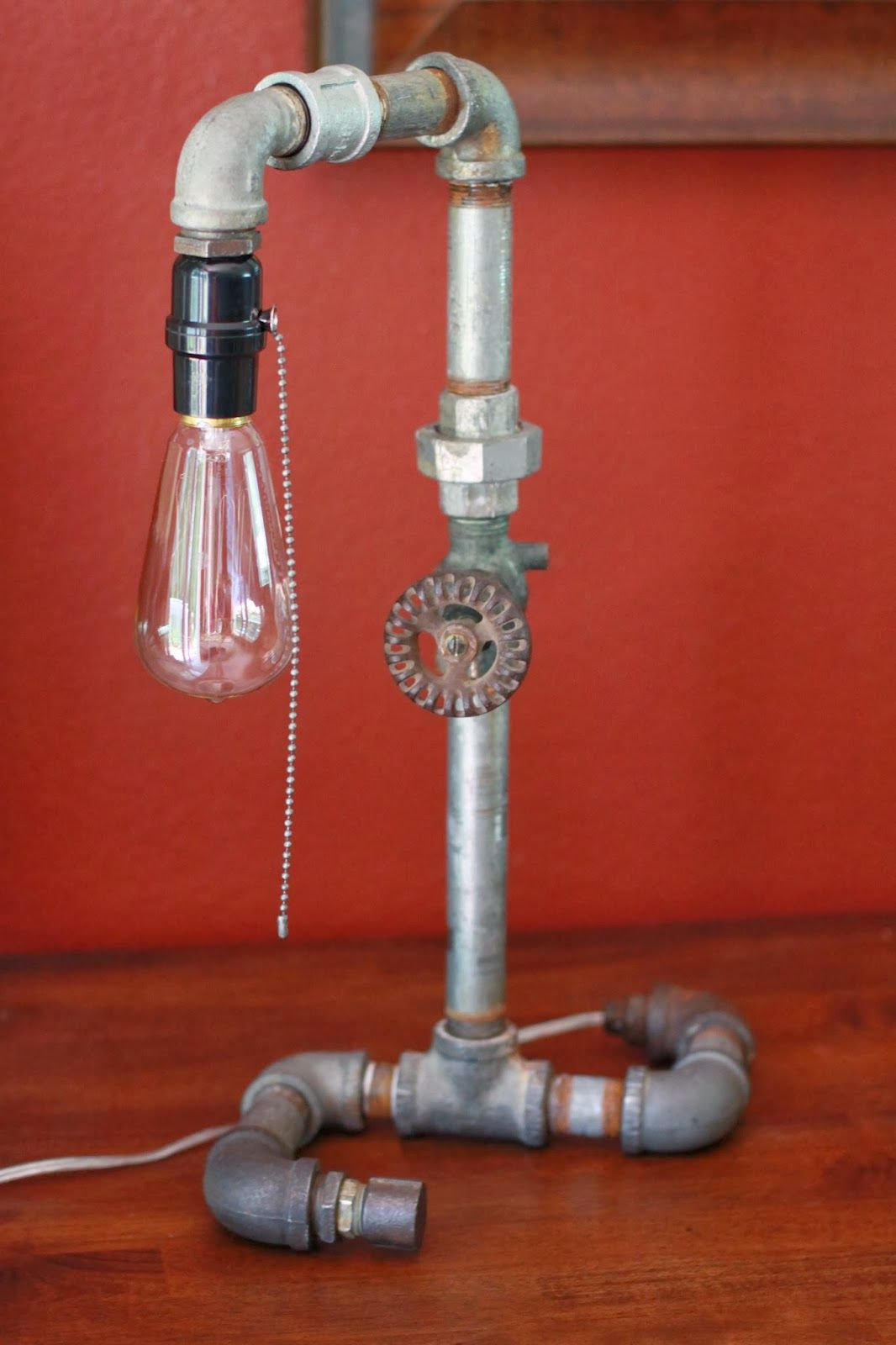 This blogger\'s husband made lamps from vintage plumbing parts. Love ...
