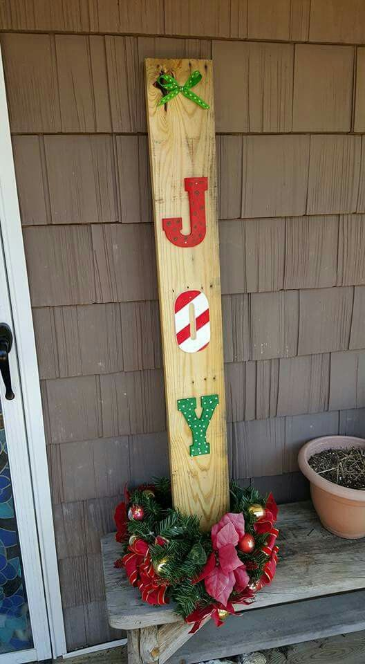 Painted Christmas letter's on pallet wood.