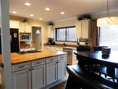 Butcher Block Countertop On Large Center Island, Granite Countertops, New  Cream Cabinets, Recessed