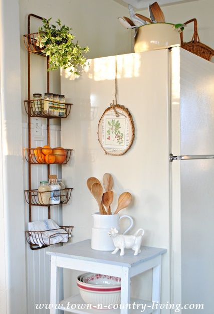 Captivating Organize Your Kitchen With A Wall Basket Hanger