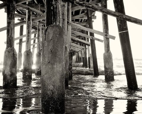 Pier by photographer: Aaron Young:  Newport Beach pier captured as the marine layer was in retreat.  prints start at $25  Buy a photograph. Select a charity.
