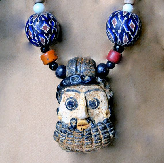 The focal of this necklace is a modern reproduction of a glass reserved handcrafted primitive phoenician mask glass face pendant with large mosaic glass beads vintage millefiori naga beads aloadofball Choice Image