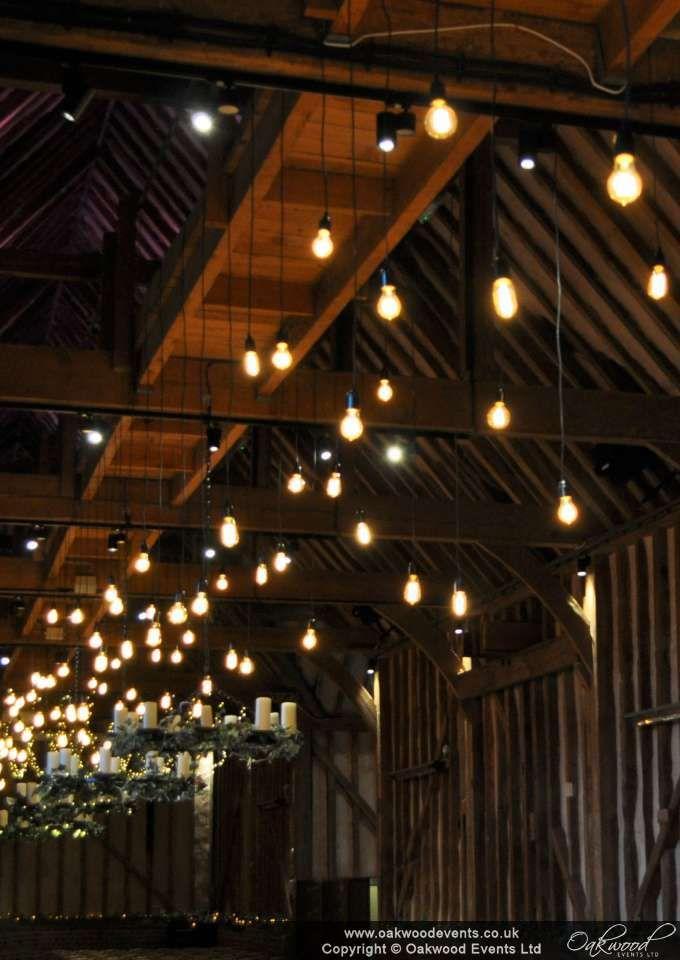bare bulb canopy of edison filament bulbs for a stylish autumn barn