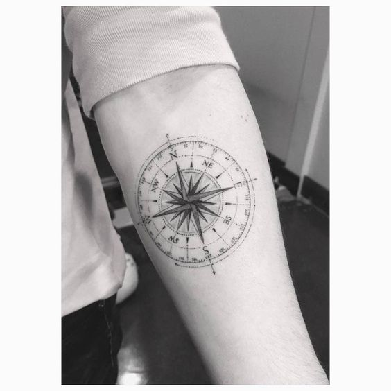 5d76dc5b0b6aa Fine line compass tattoo on Brooklyn Beckham's left inner forearm. Tattoo  Artist: Dr.
