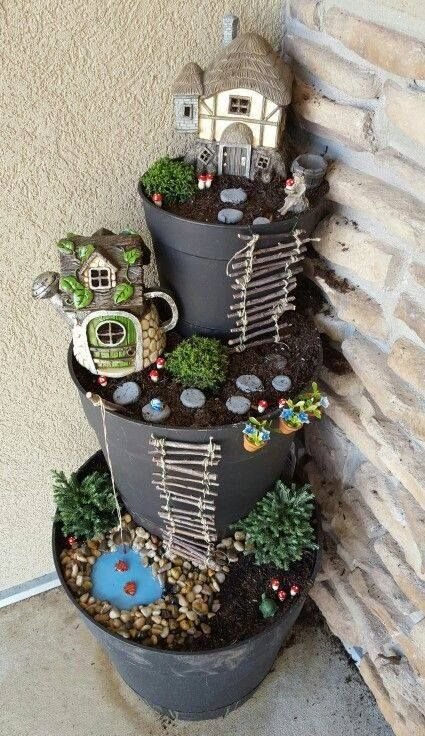 Beautiful 3-tier DIY fairy garden with little houses and a fish pond