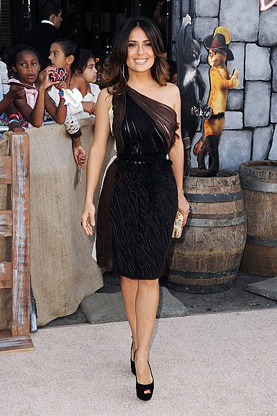 """Selma Hayek--""""The draping and print of this dress move vertically on the body and vertical lines always slim and narrow the figure because they draw the eye up and down."""" """"A belt at the waist or a cinched waistline is always flattering for a curvy girl, too, because they define the waist. Opt for lower necklines for a slimming effect—high necklines tend to cut-off or stump a petite, curvy figure.""""   youbeauty.com"""