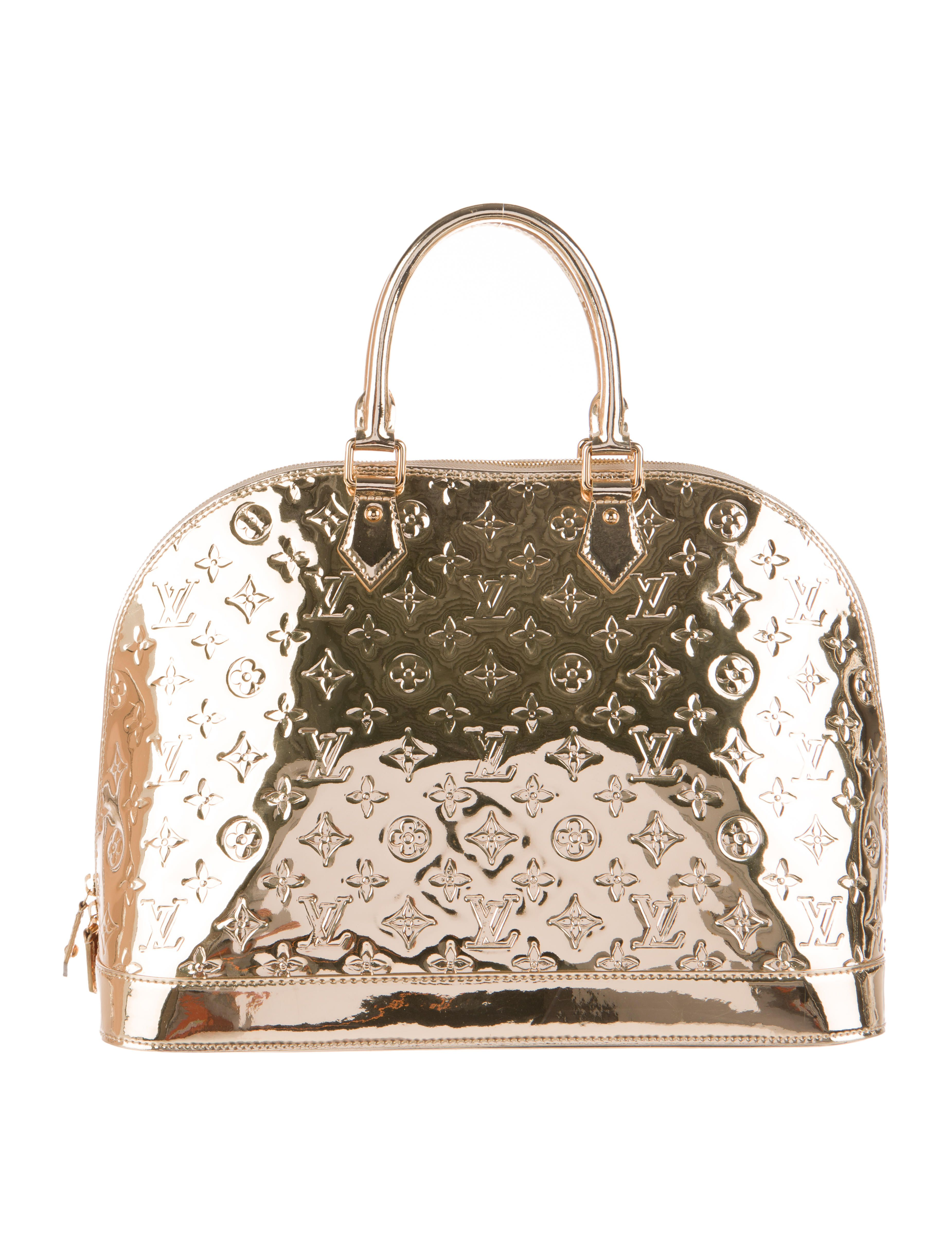 Gold Miroire leather Louis Vuitton Alma MM with gold-tone hardware, two rolled handles, beige canvas lining, two wall pockets and top two-way zip closure. Date code reads MI4048. Shop authentic designer handbags by Louis Vuitton at The RealReal.