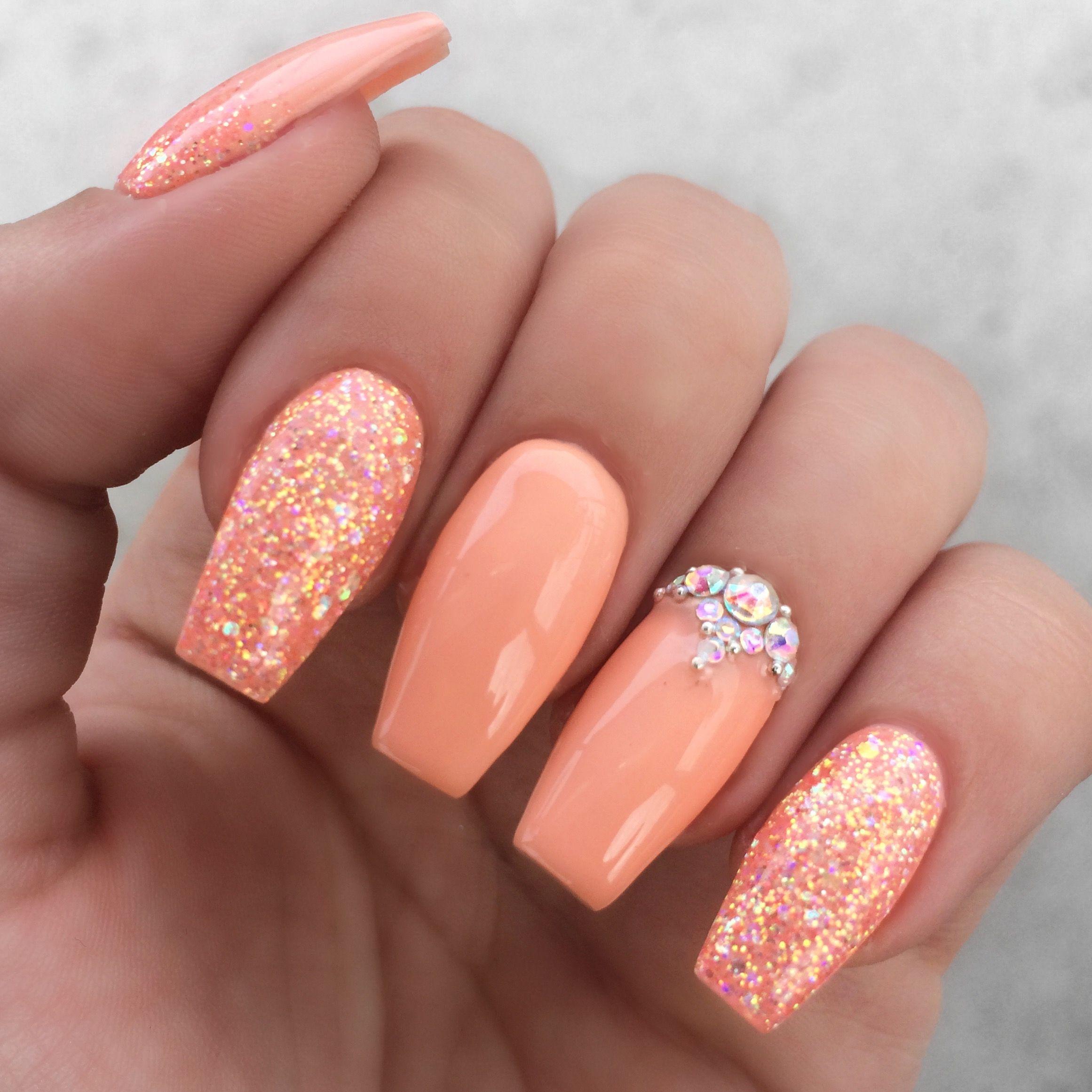Girly peach glitter rhinestone nails
