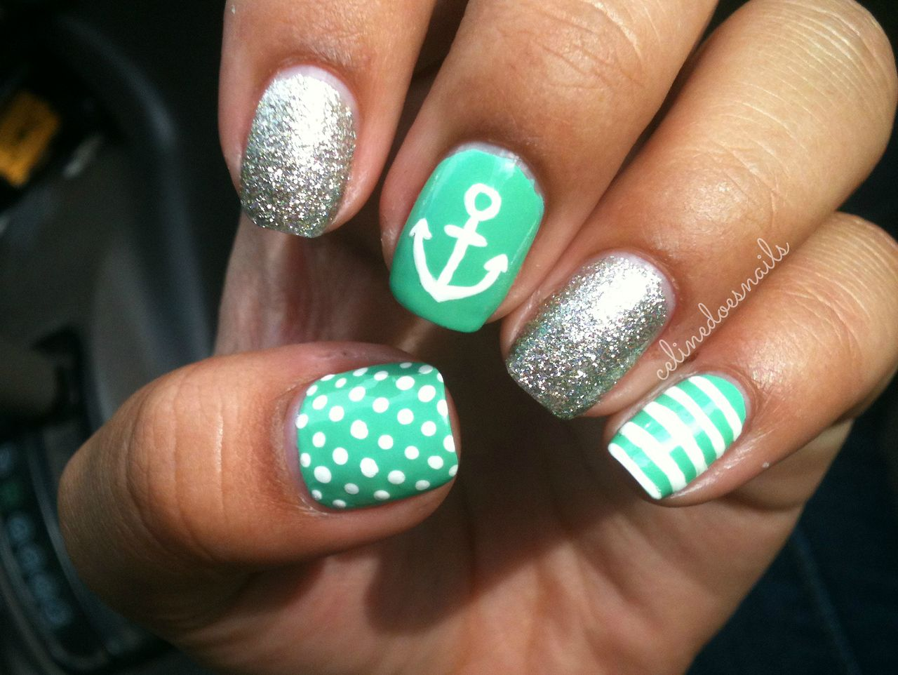 I love the thumb nail turquoise with white polka dots nails