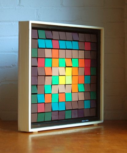 Rotating cube wall sculpture by Mitra