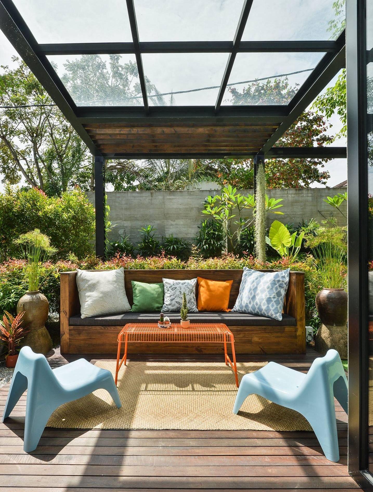 A comfy couch in the house garden.  Designer: Archiplan Interior