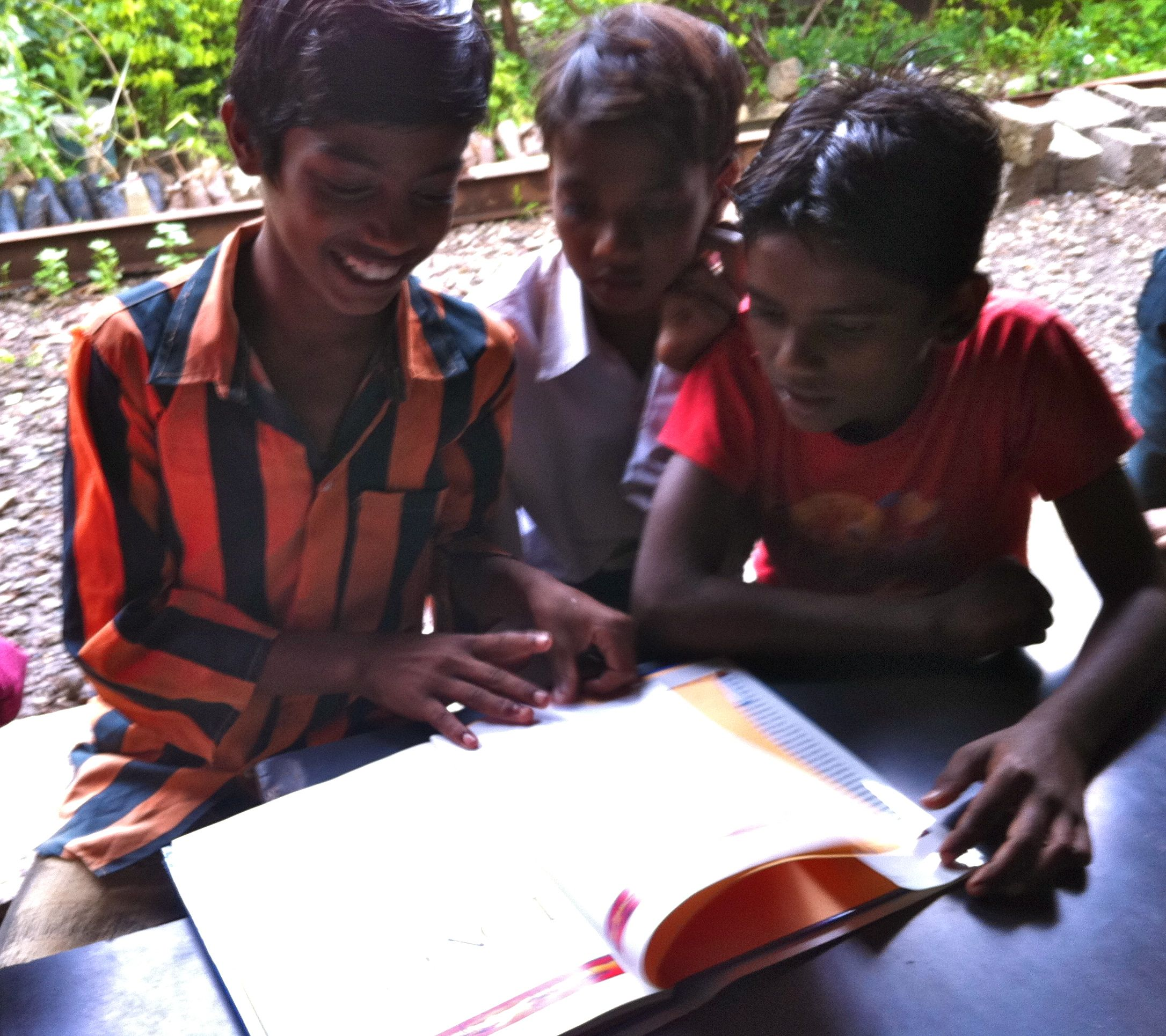 Boys enjoying a book an orphanage outside of mumbai