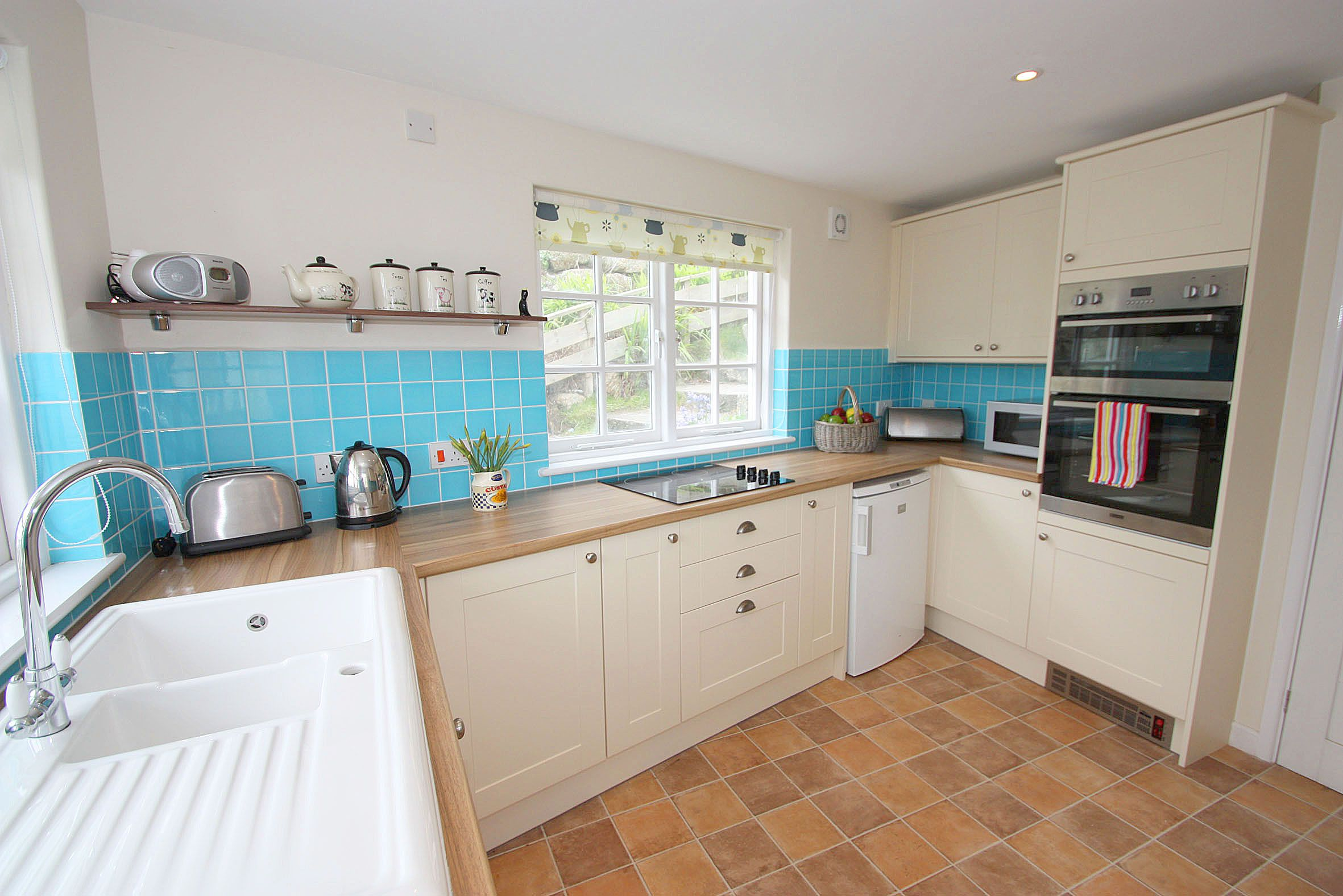 A prominent landmark in the village having previously been a tea room, Myrtle Cottage now offers flexible accommodation for six guests in four bedrooms. From £463 per week.  http://www.cornishcottageholidays.co.uk/html/property_detail.php?pid=1204