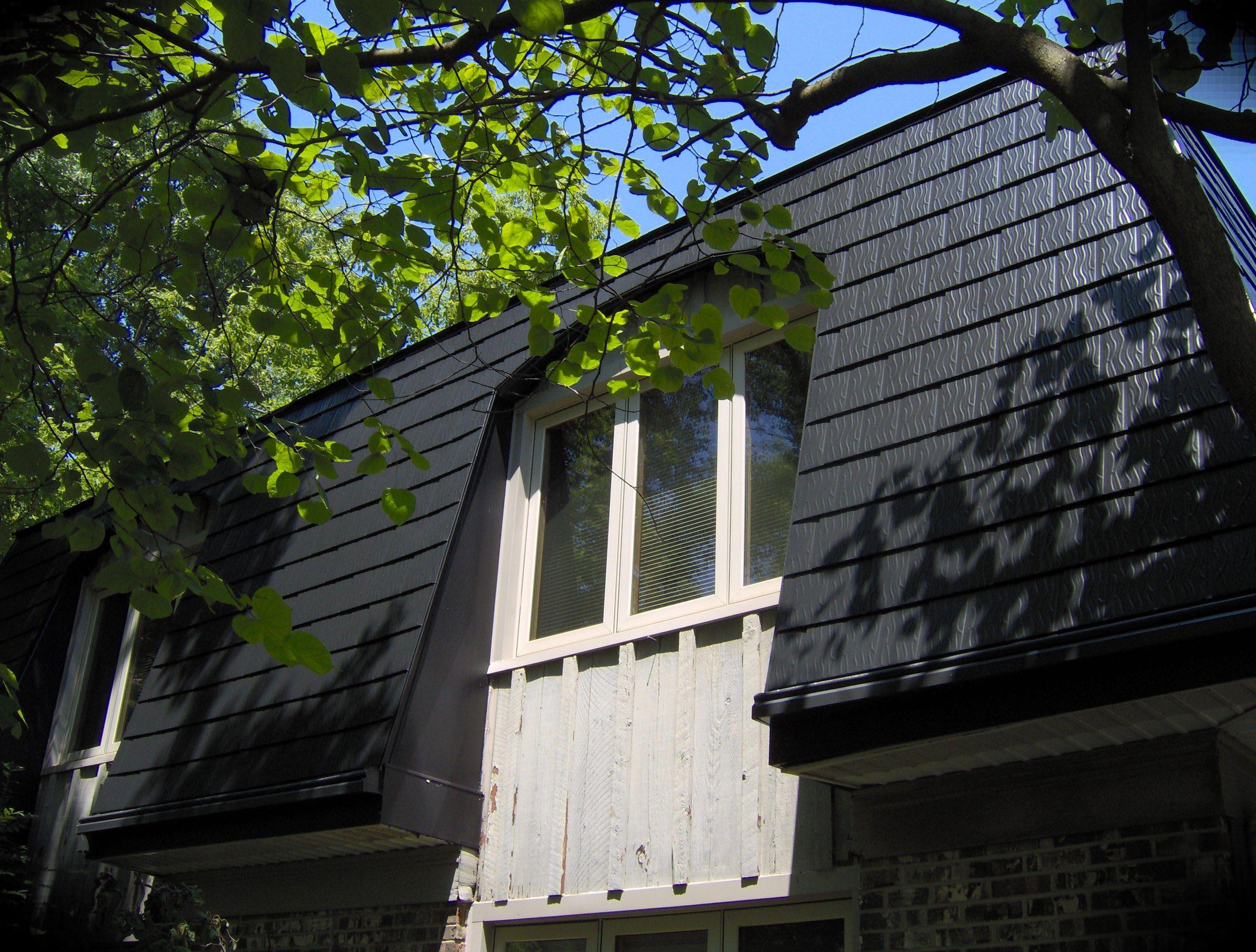 Black Interlock Shingles On A Mansard Style Home Metal