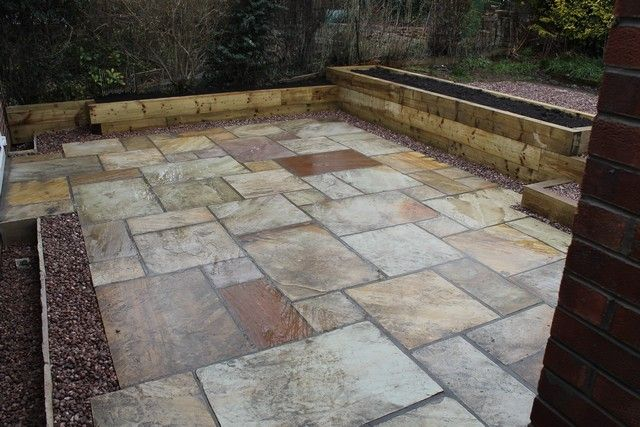 Fossil mint Indian stone patio in Sheffield with raised ...