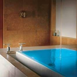 Bathroom tech Integration. Imitating a zero-edge pool, the two ...