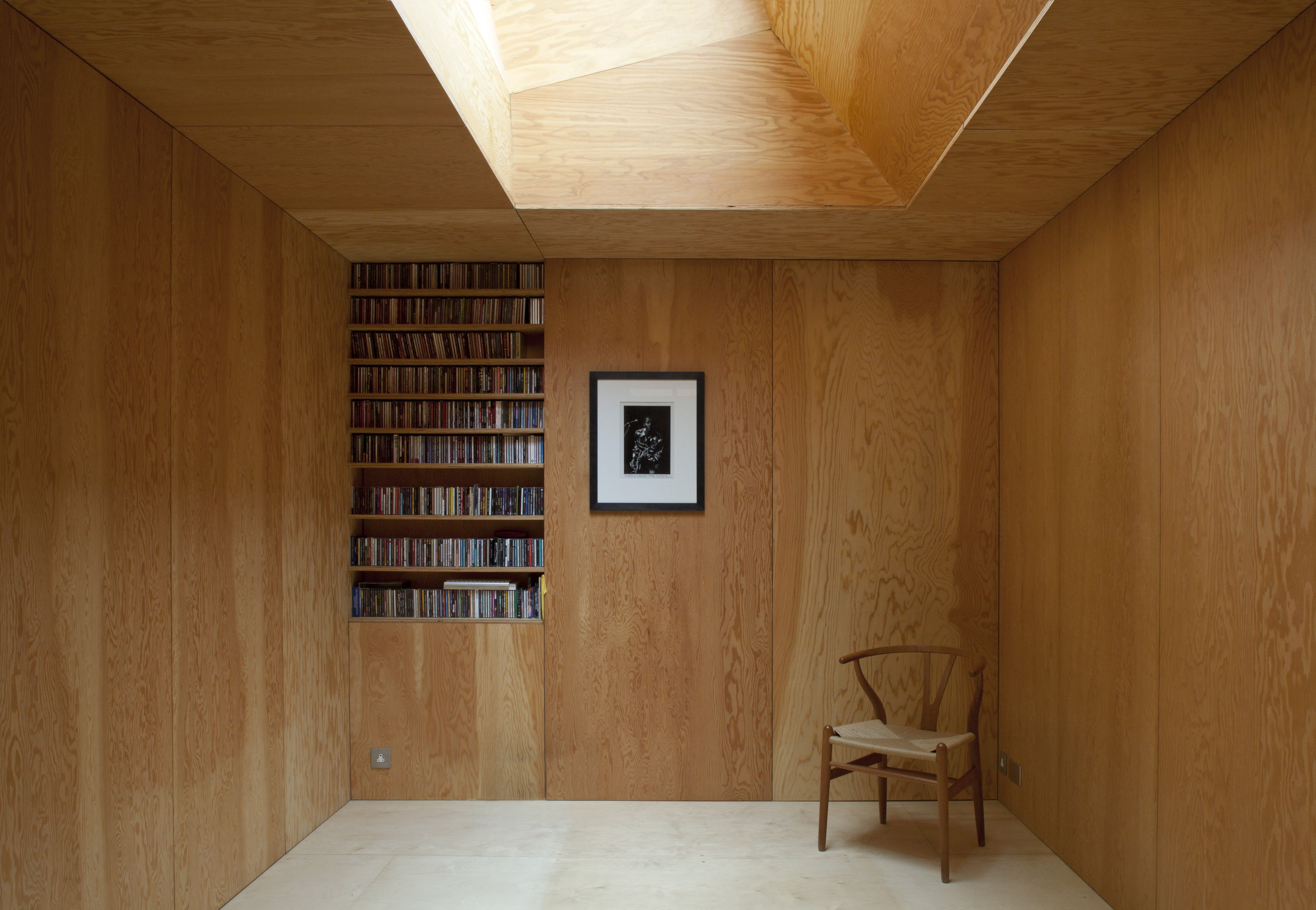 Frame House | Jonathan Tuckey Design, Holland Park, London, UK   A Hans  Wegner Wishbone Chair Sits In A Room Finished In Douglas Fir Plywood  Paneling.