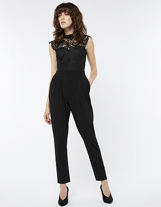 ac98be31b096 Adopt a chic evening look in the Olga lace jumpsuit. Its beautiful lace  bodice has a high neck and cut-out back