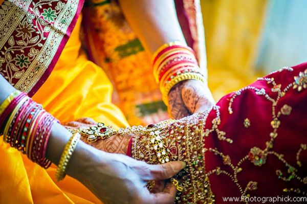 indian-wedding-bride-getting-dressed-for-ceremony http://maharaniweddings.com/gallery/photo/3158