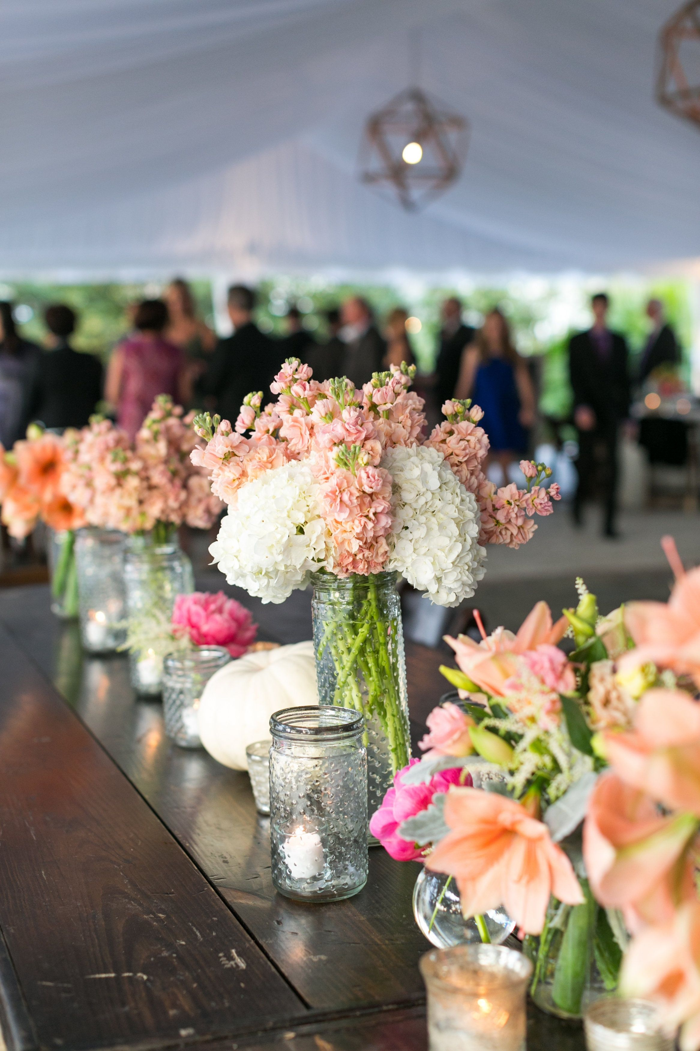 Pastel Flowers in Dotted Mason Jars for Reception Decor | Dana Cubbage Weddings | theknot.com