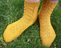 Gold Leaf Socks pattern free from Designer Julie Claire and available on Ravelry