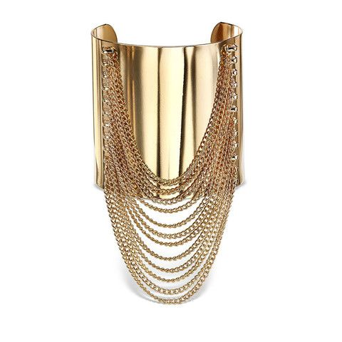 Gold fringe cuff bracelet features chain link fringe that dangles gracefully from an adjustable cuff.