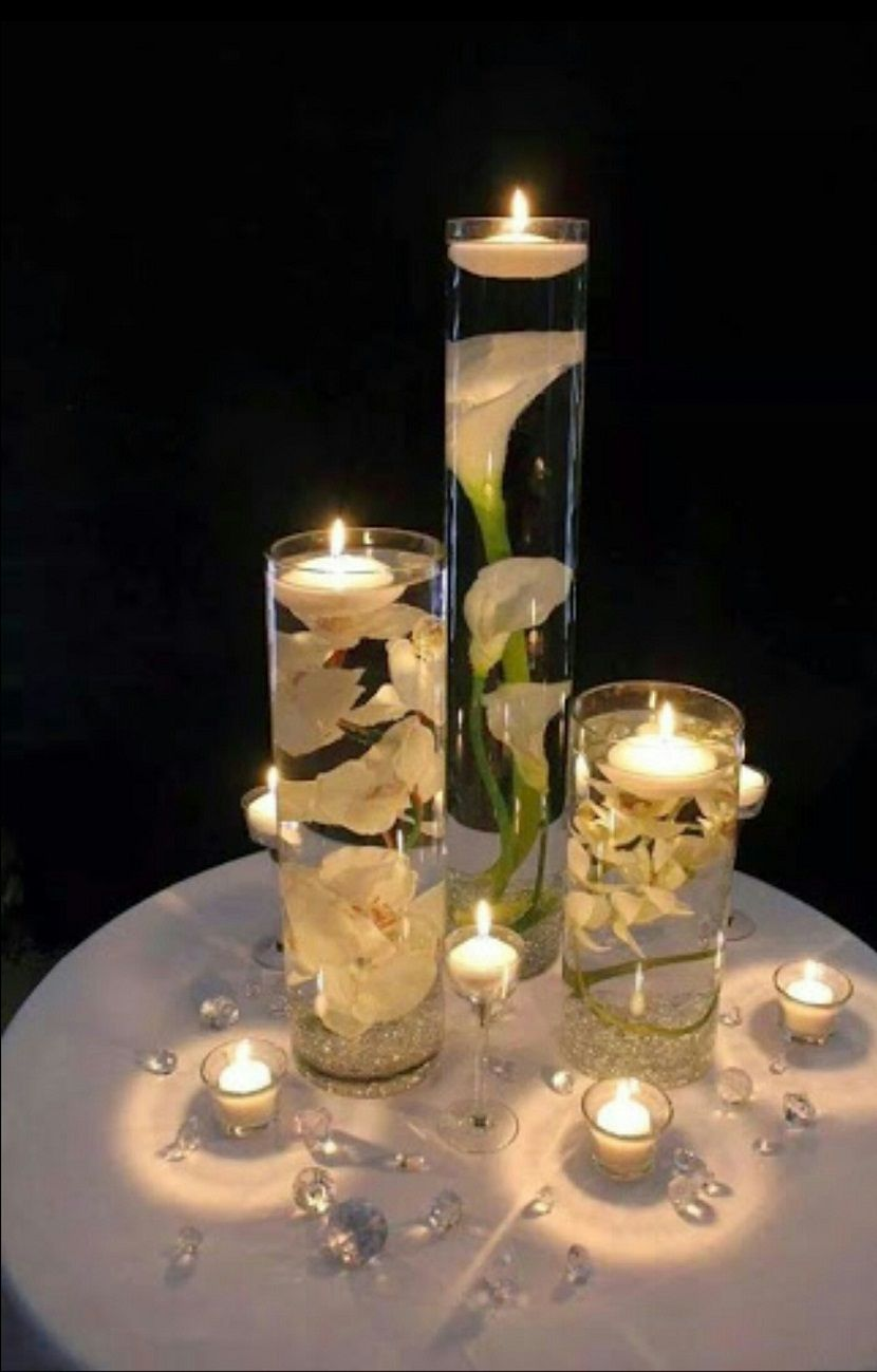 The Table Centerpiece For New Year S Eve With Flower Candles Beautiful Wedding Reception Floating Candle Centerpieces Wedding Table