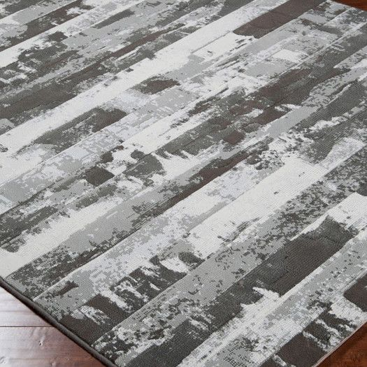 Features:  -100% Polypropylene.  -No shedding.  -Medium pile.  Technique: -Machine woven.  Primary Color: -Gray.  Material: -Synthetic.  Product Type: -Area Rug.  Material Details: -Polypropylene. Dim