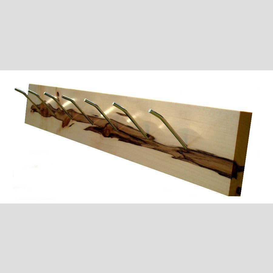 Porte manteaux en érable et acier poli. Pièces uniques à 600 euros. Réalisations avec divers matériaux à partir de 430 euros. Le clients peux fournir l' éléments en bois pour la conceptions de sa pièce.