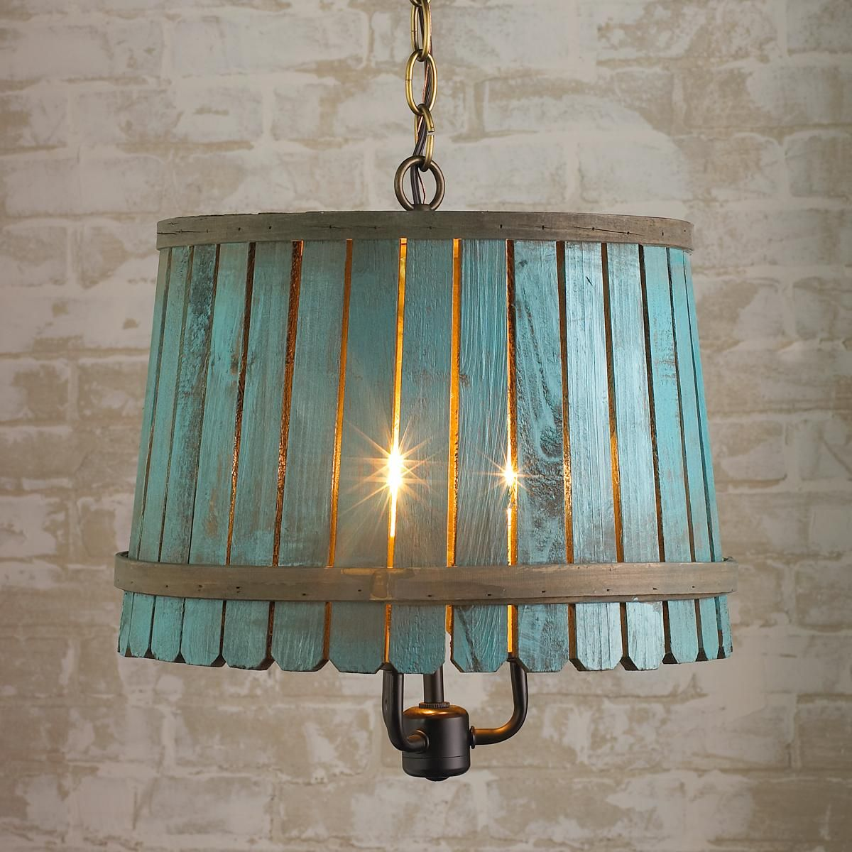I love this!  Anybody have an idea how you could DIY?  I want to try it - at the very least you could cut out a hole and put an IKEA hanging lamp kit through.  Oh, and would have to get a hanging chain.